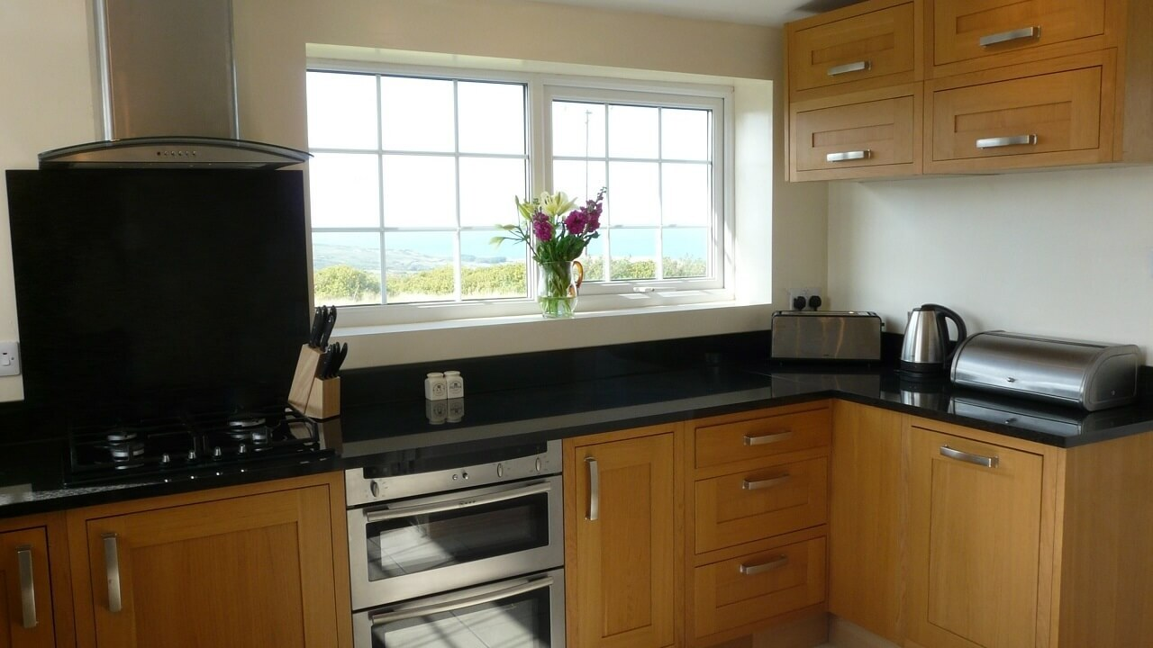 Oak and granite kitchen with sea views